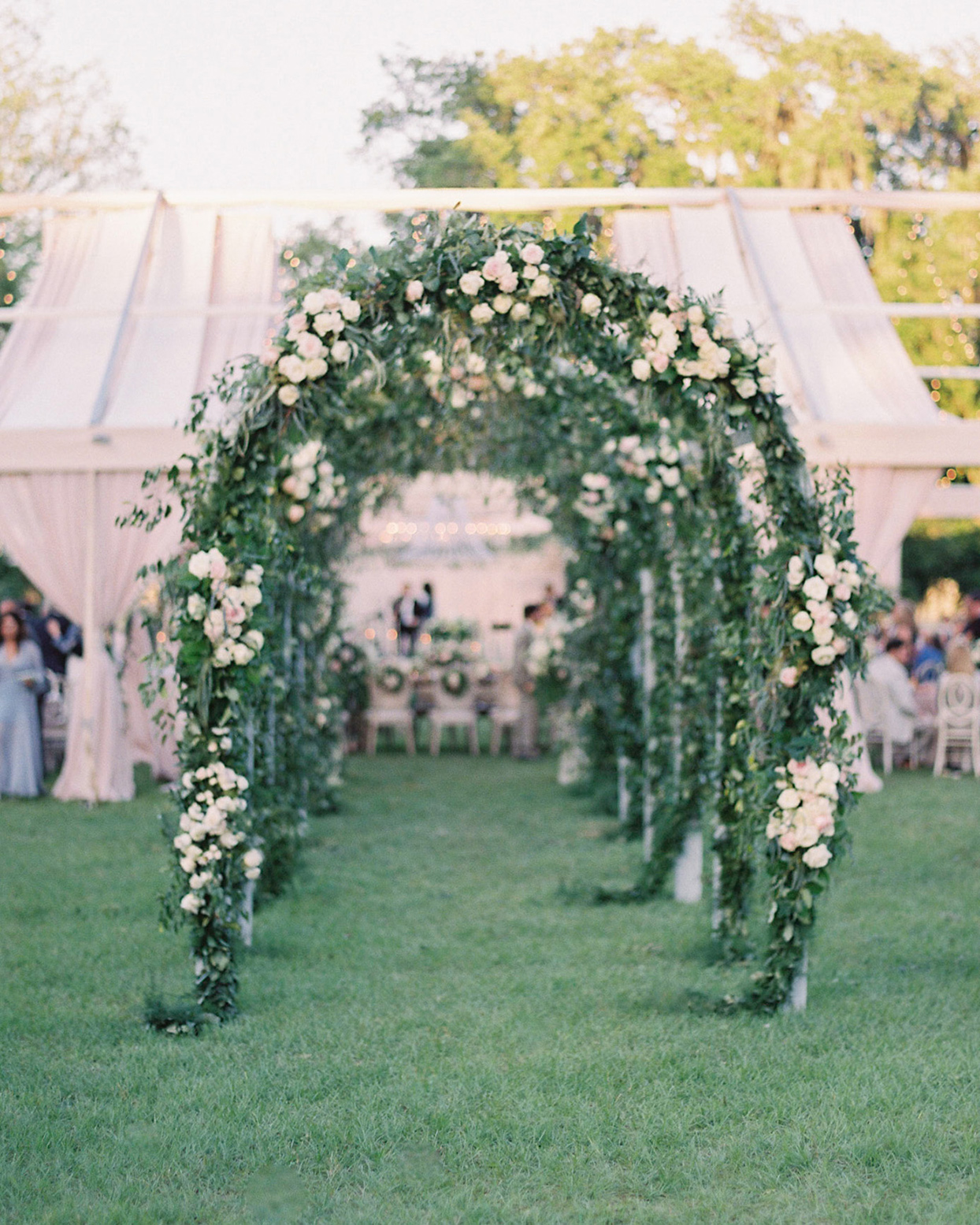 chelsea john wedding reception greenery and floral arches