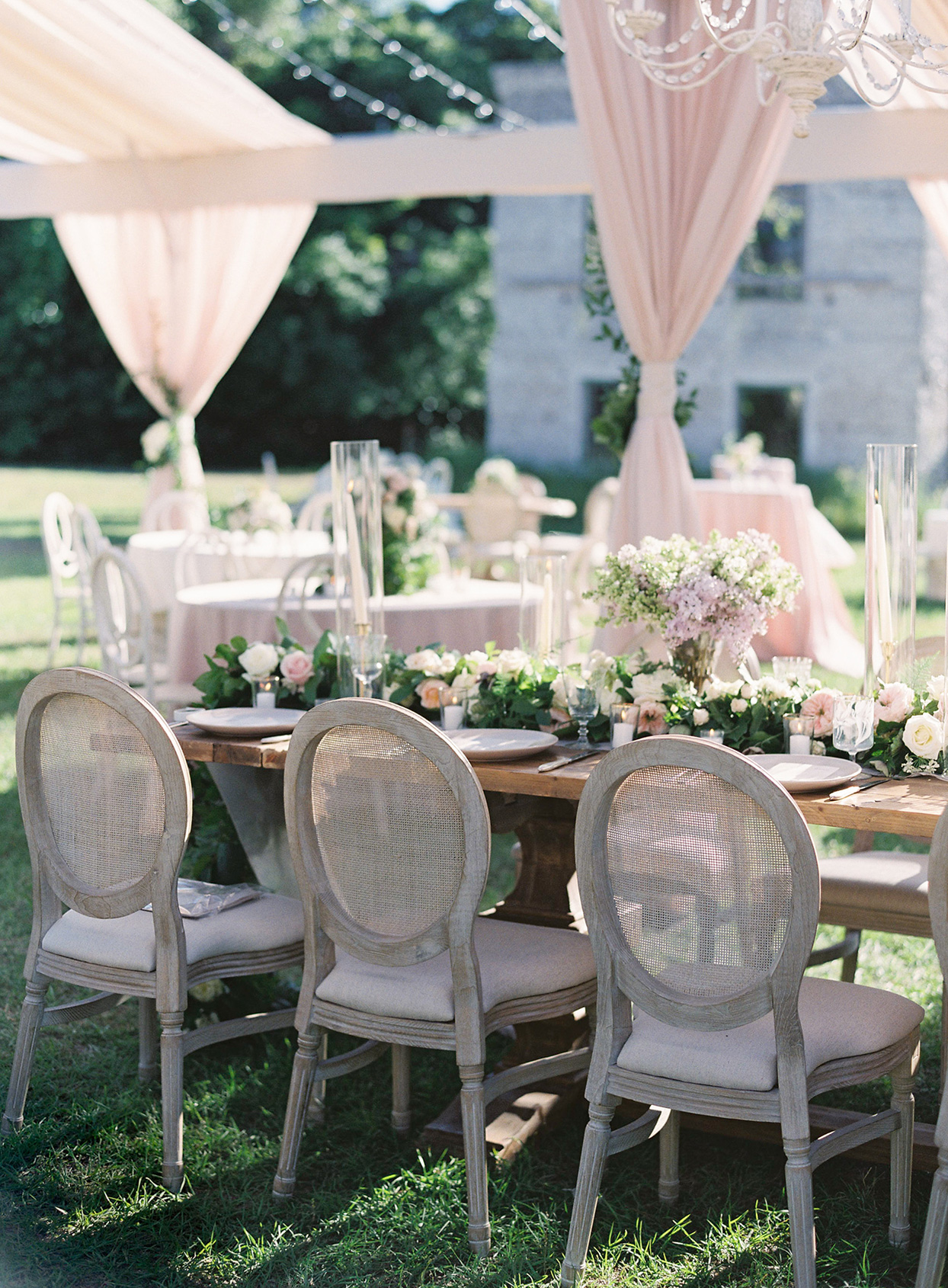 chelsea john wedding reception tables until pastel pink tent