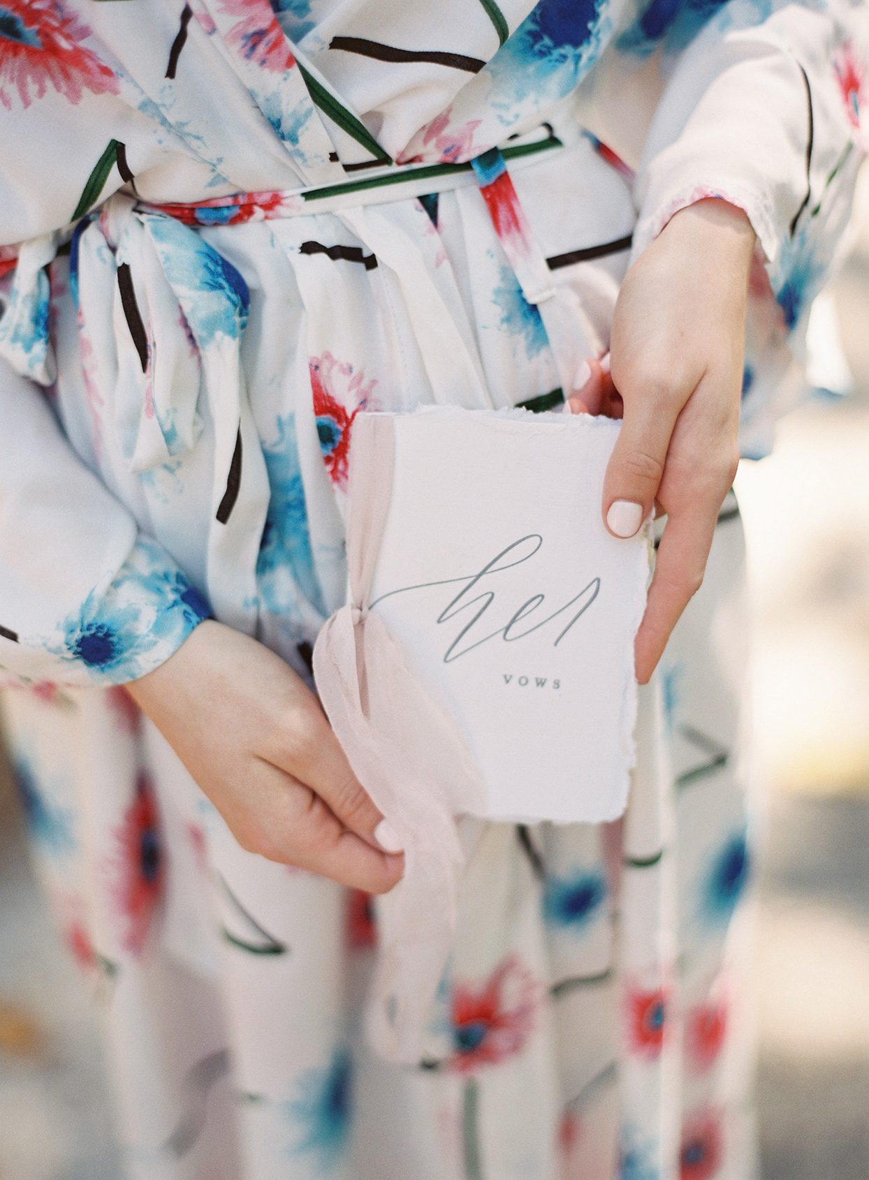chelsea john wedding bride in floral robe holding vow book
