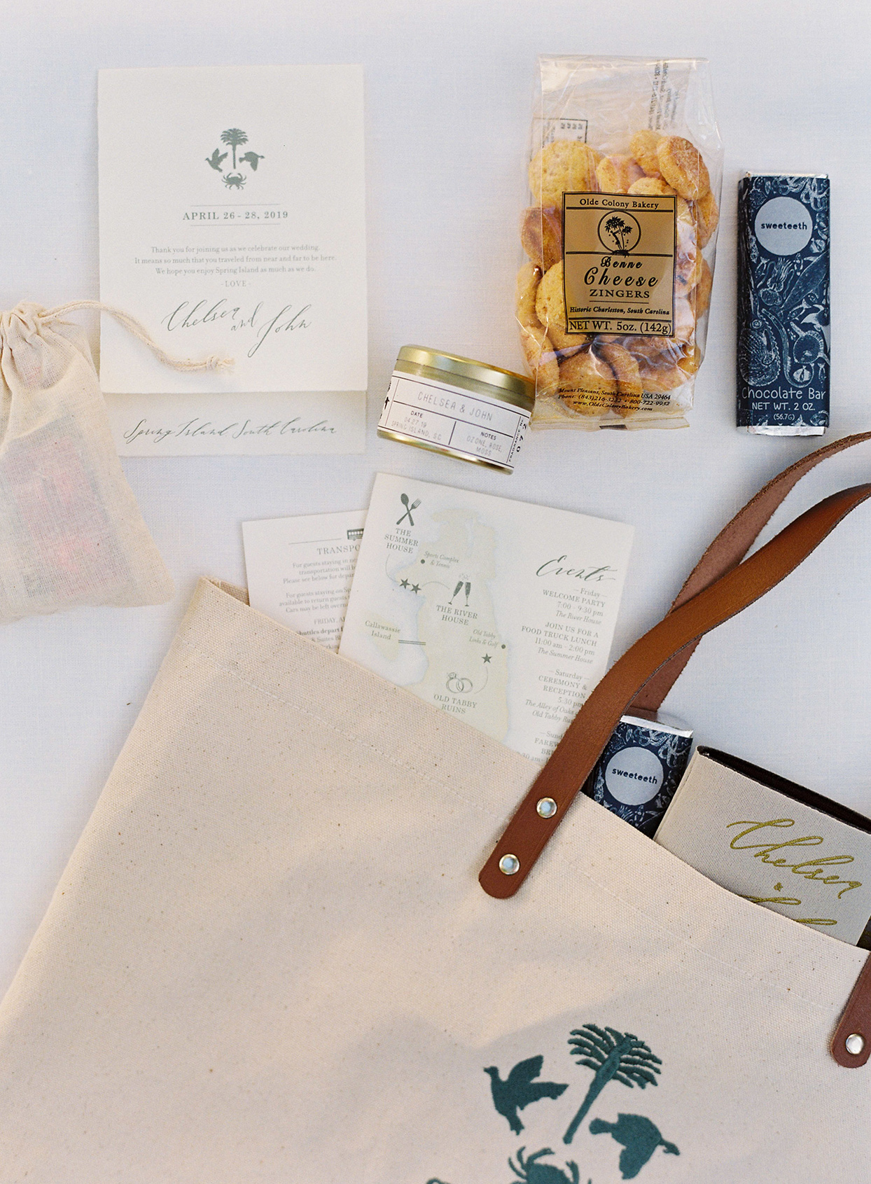 chelsea john wedding bags with snacks, schedules, and a candle