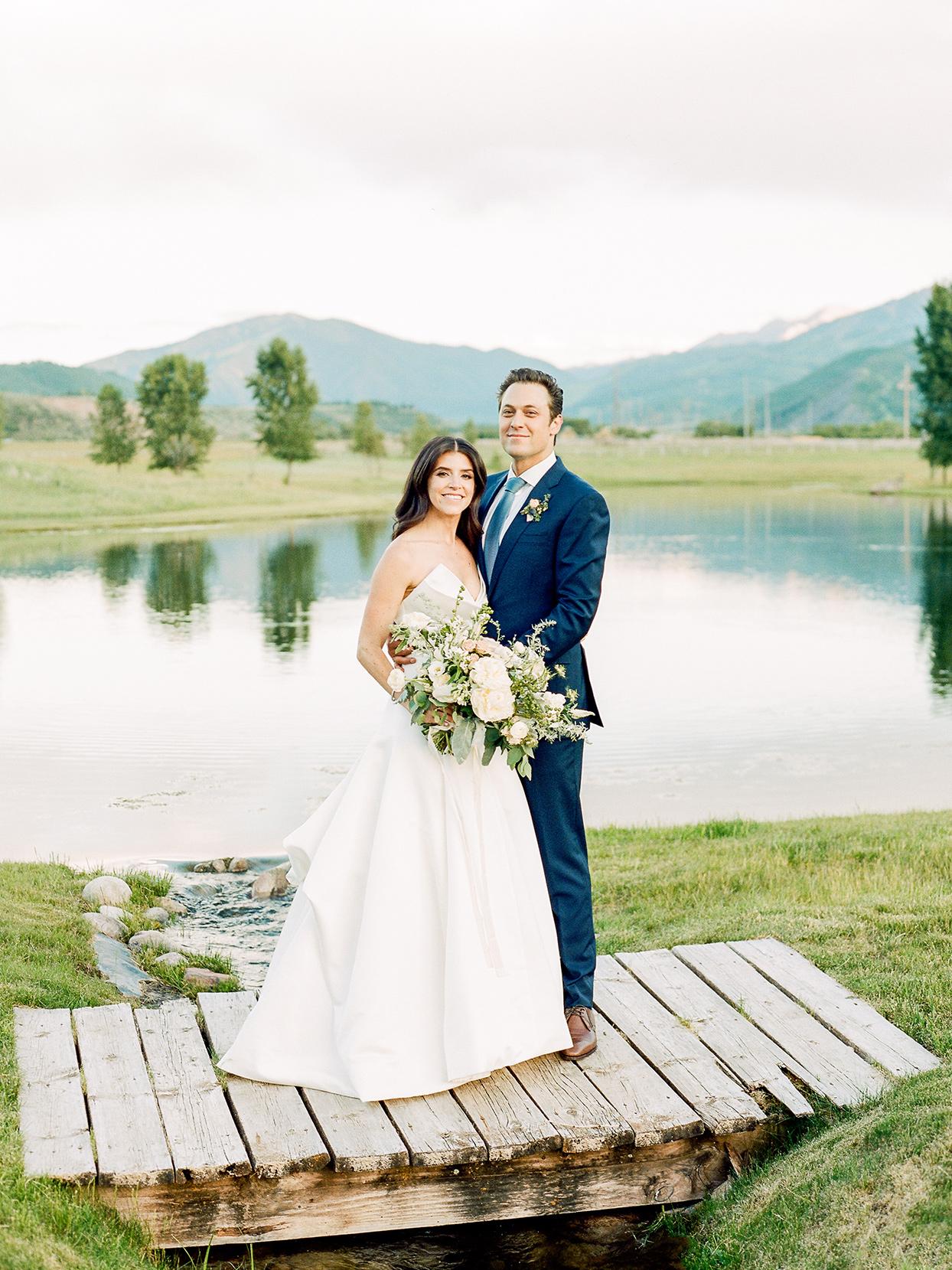 jessica aaron wedding couple on wooden bridge by brook