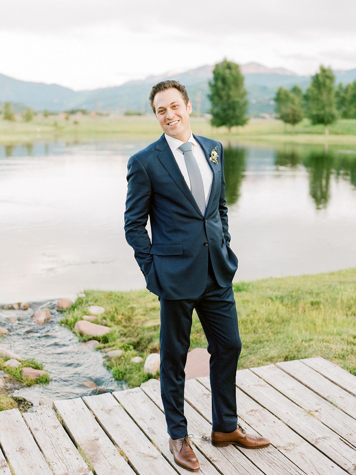 jessica aaron wedding groom on bridge