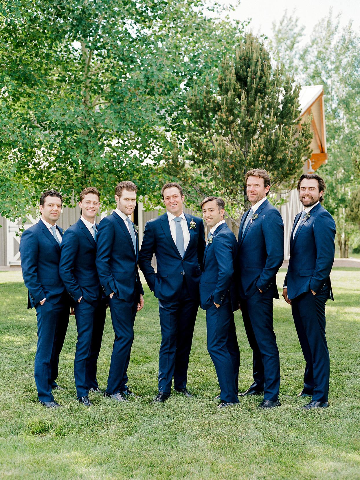 jessica aaron wedding groomsmen in blue