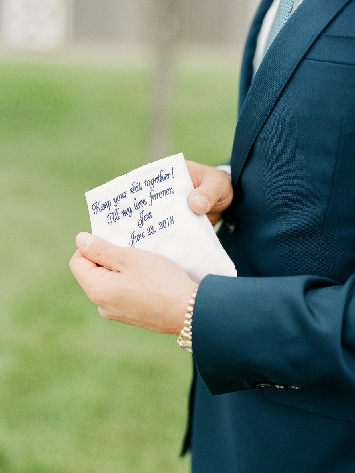 jessica aaron wedding handkerchief in groom's hand