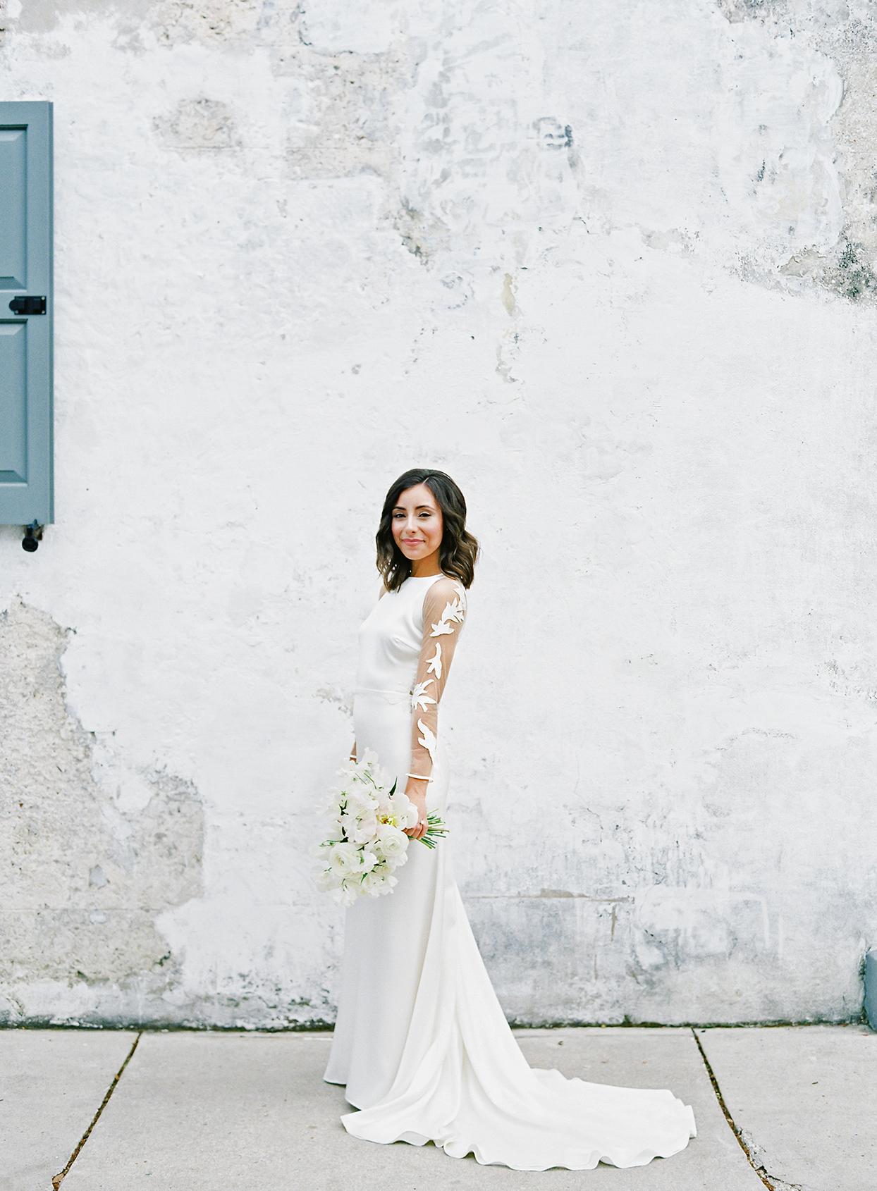 paula terence wedding bride against rough wall