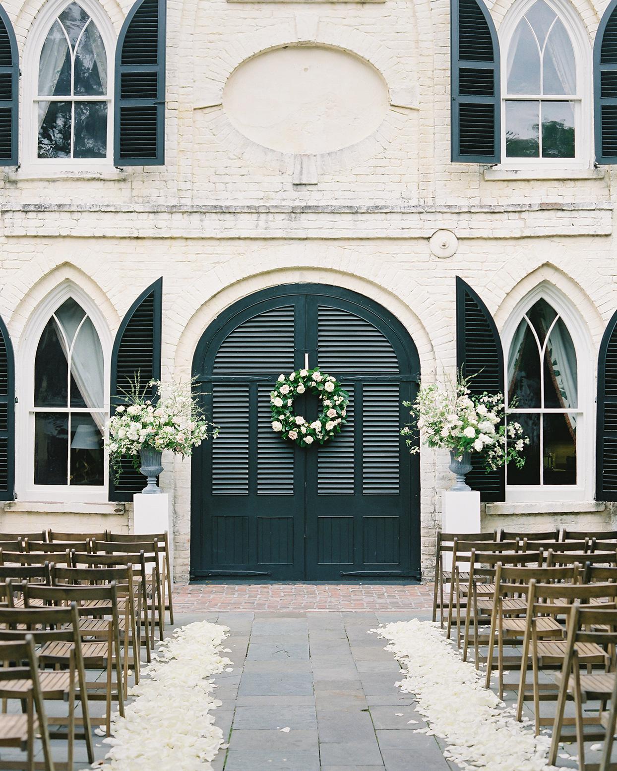 paula terence wedding ceremony location black doors with wreath