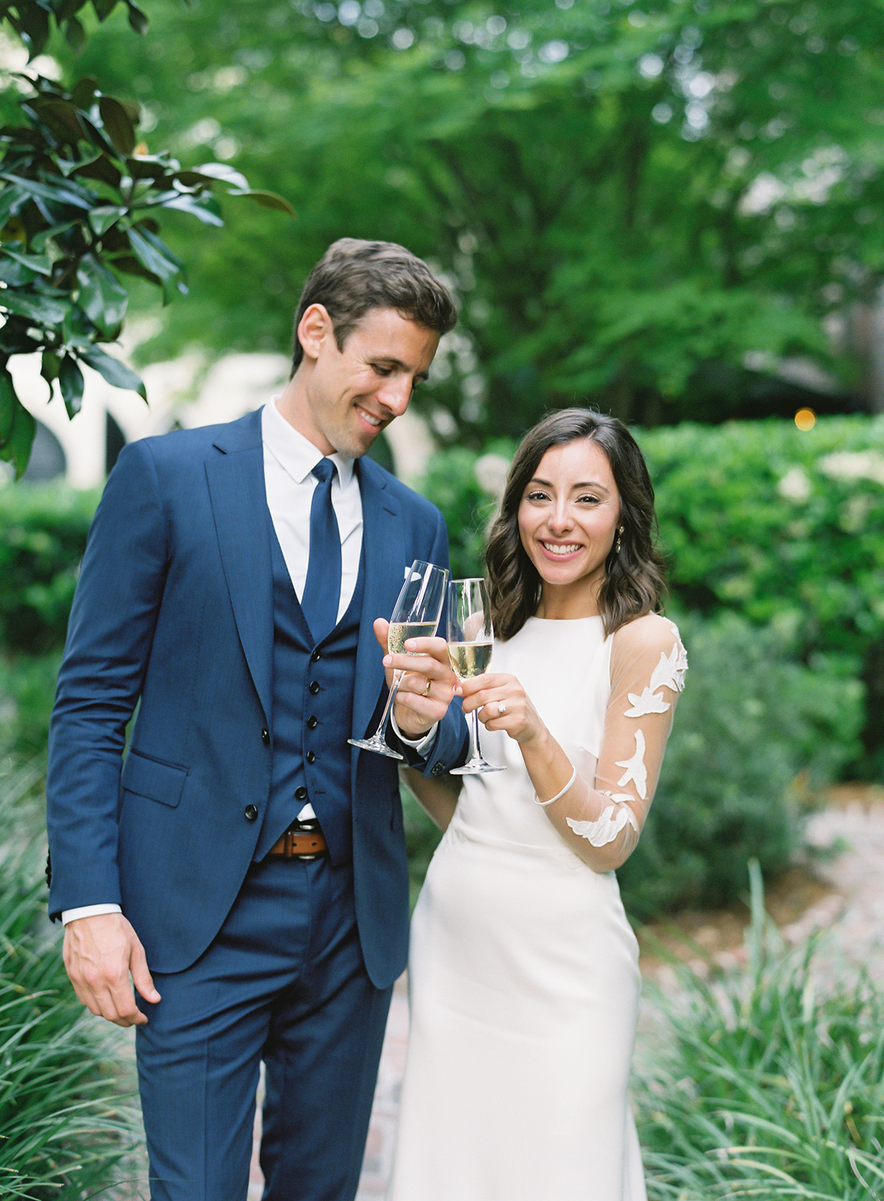 paula terence wedding couple toasting champagne