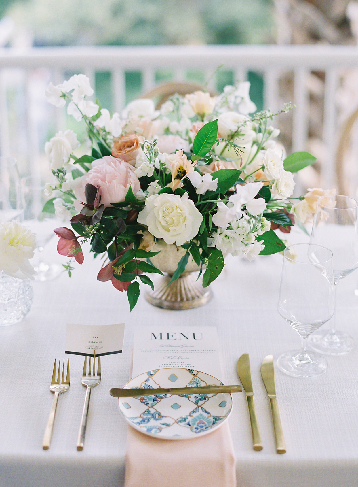 paula terence wedding place setting and floral centerpiece