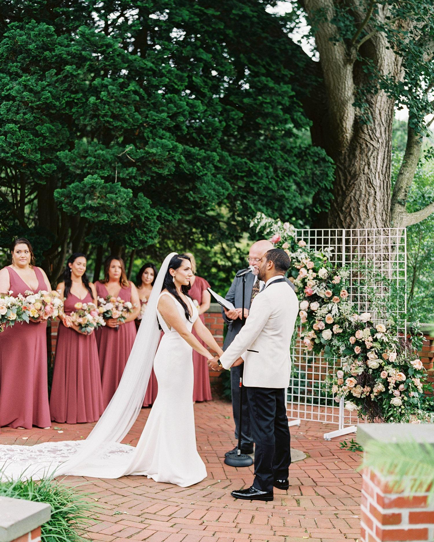 noel mike wedding ceremony couple holding hands
