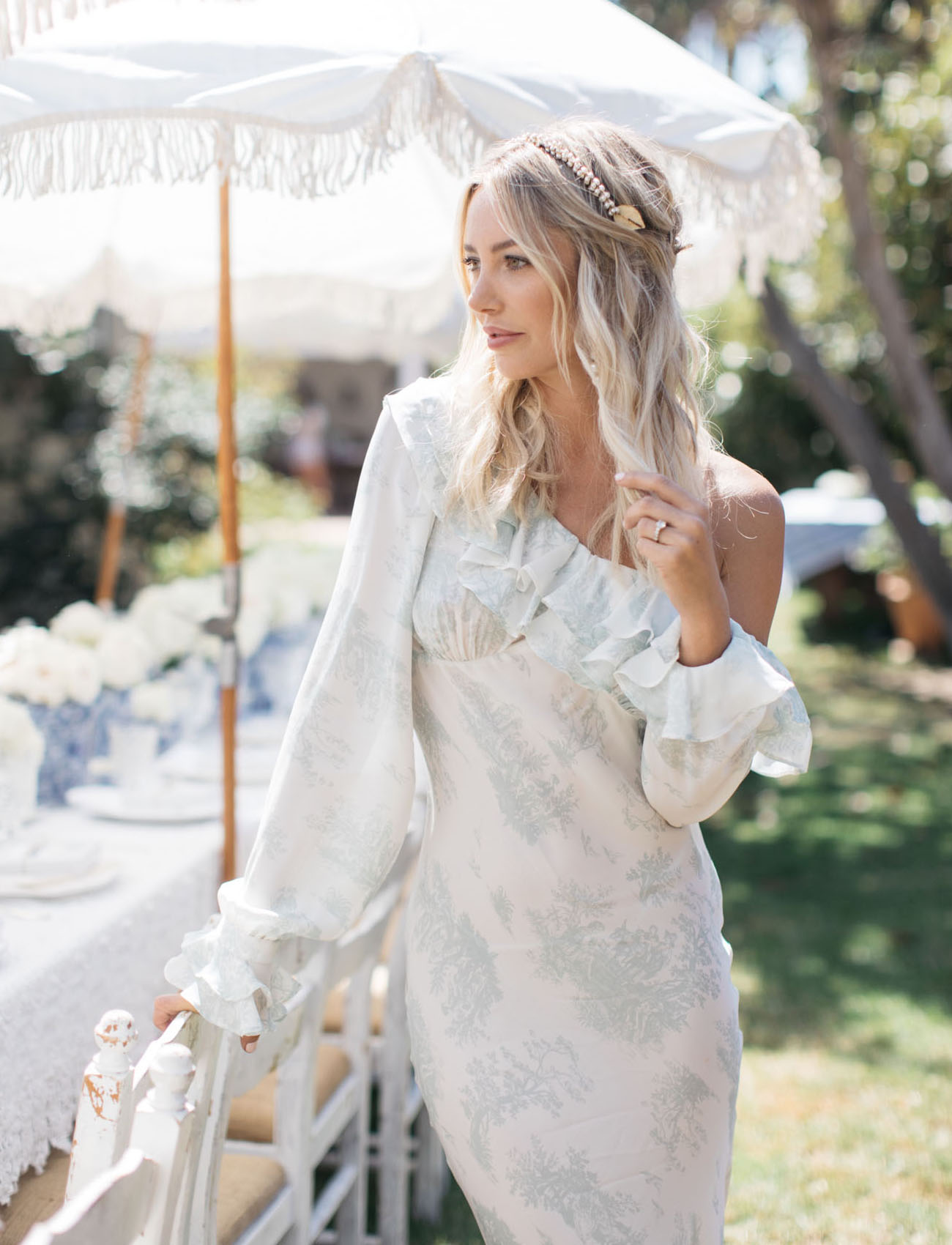 summer bridal shower woman standing at white table