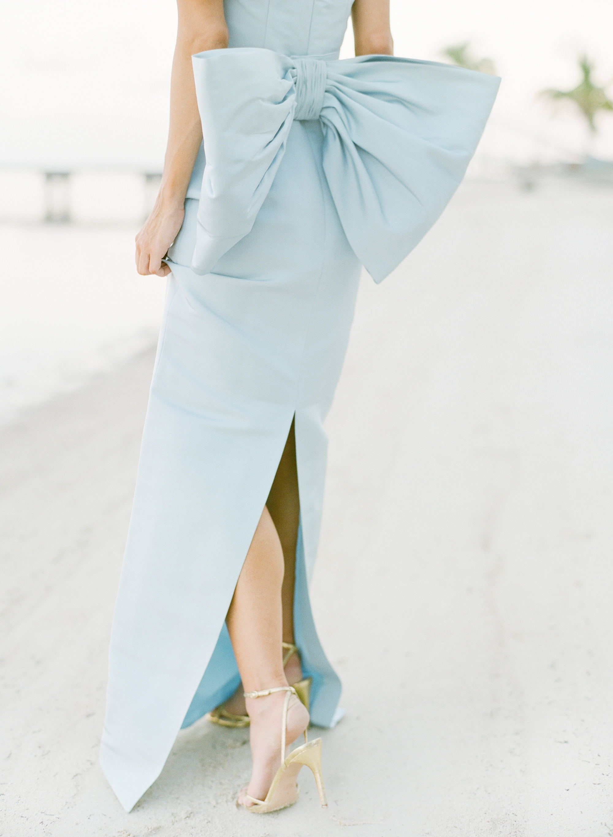 light blue wedding dress with large bow lower back
