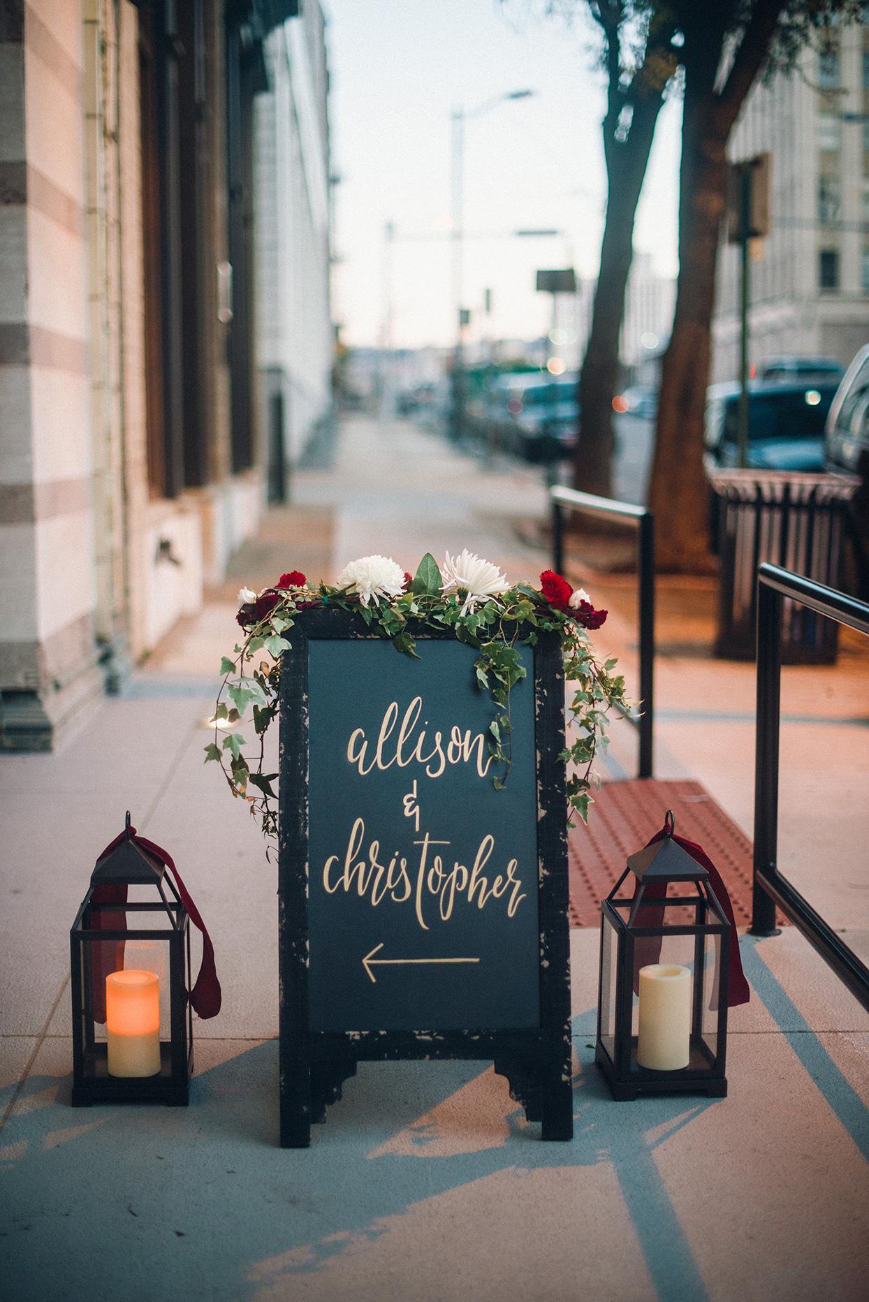 rustic sandwich board outside restaurant wedding reception