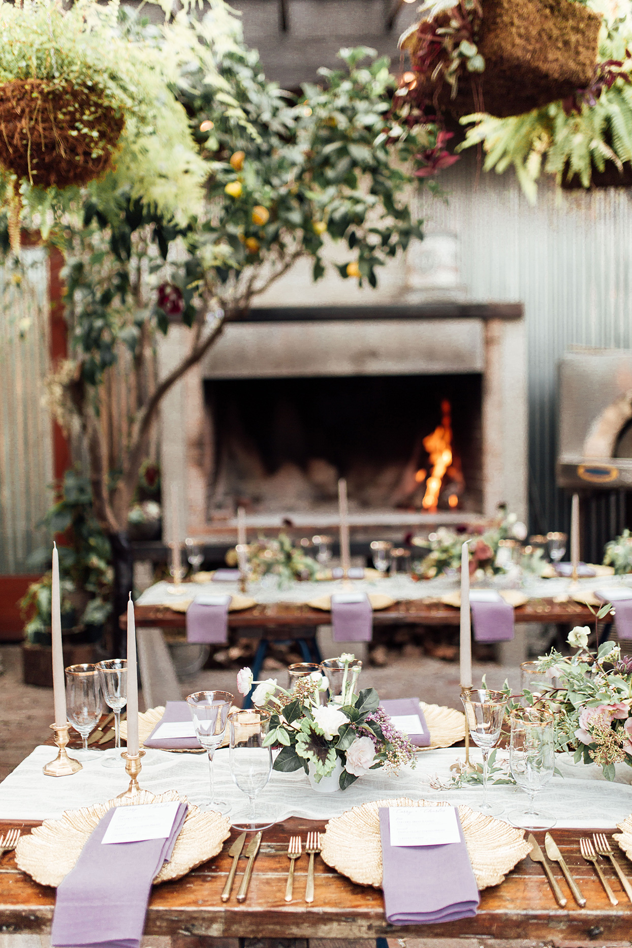 rustic wedding reception place settings in plum
