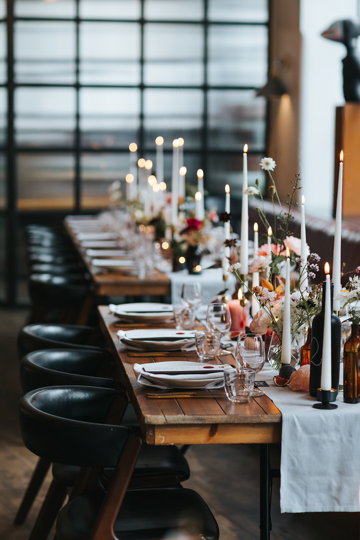 black leather chairs at rustic wooden reception table