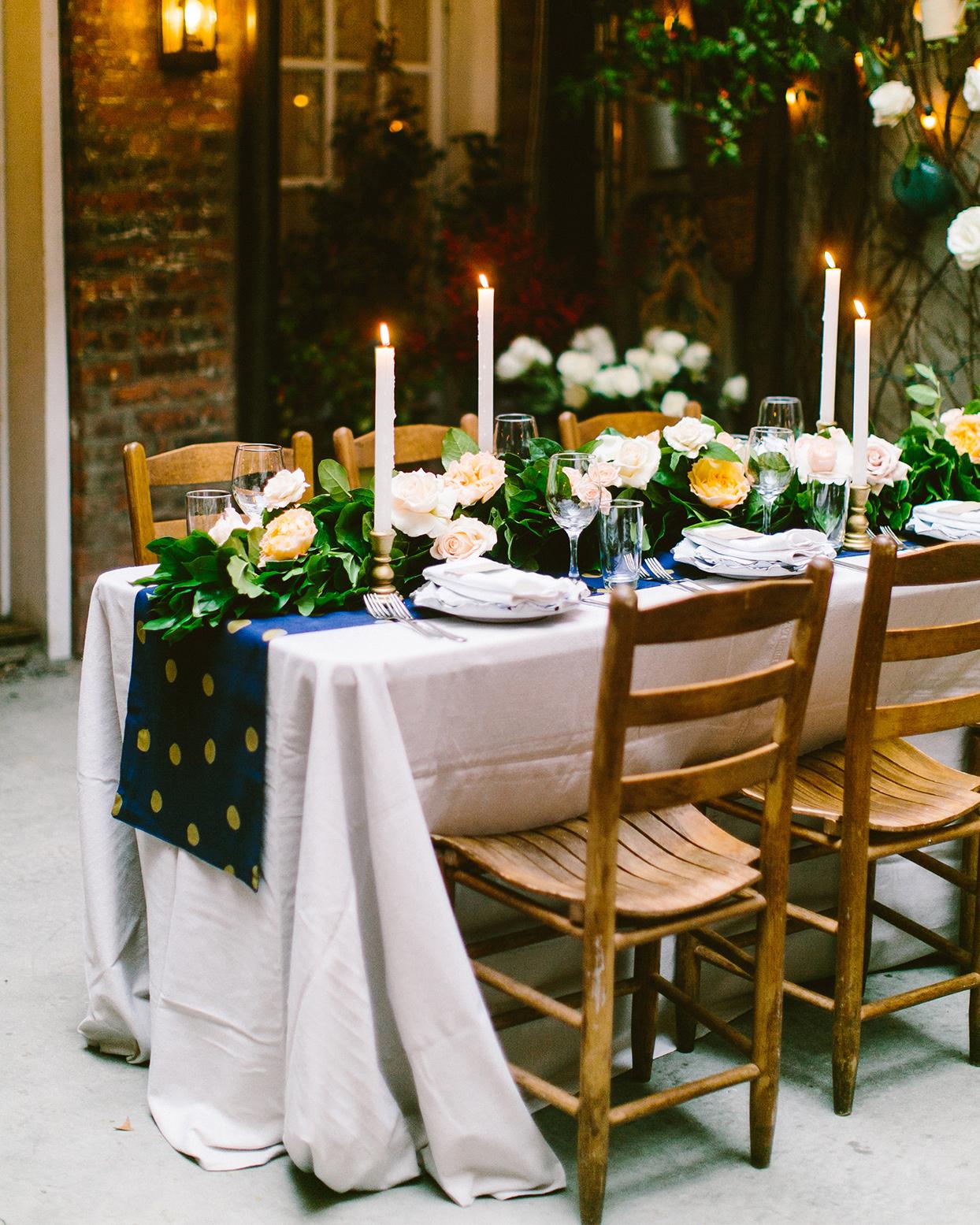 floor length white linens on reception table