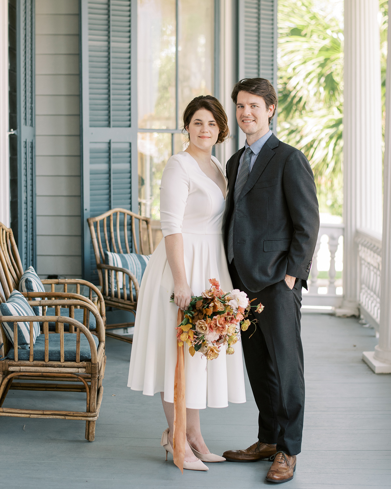elizabeth scott wedding couple standing on porch