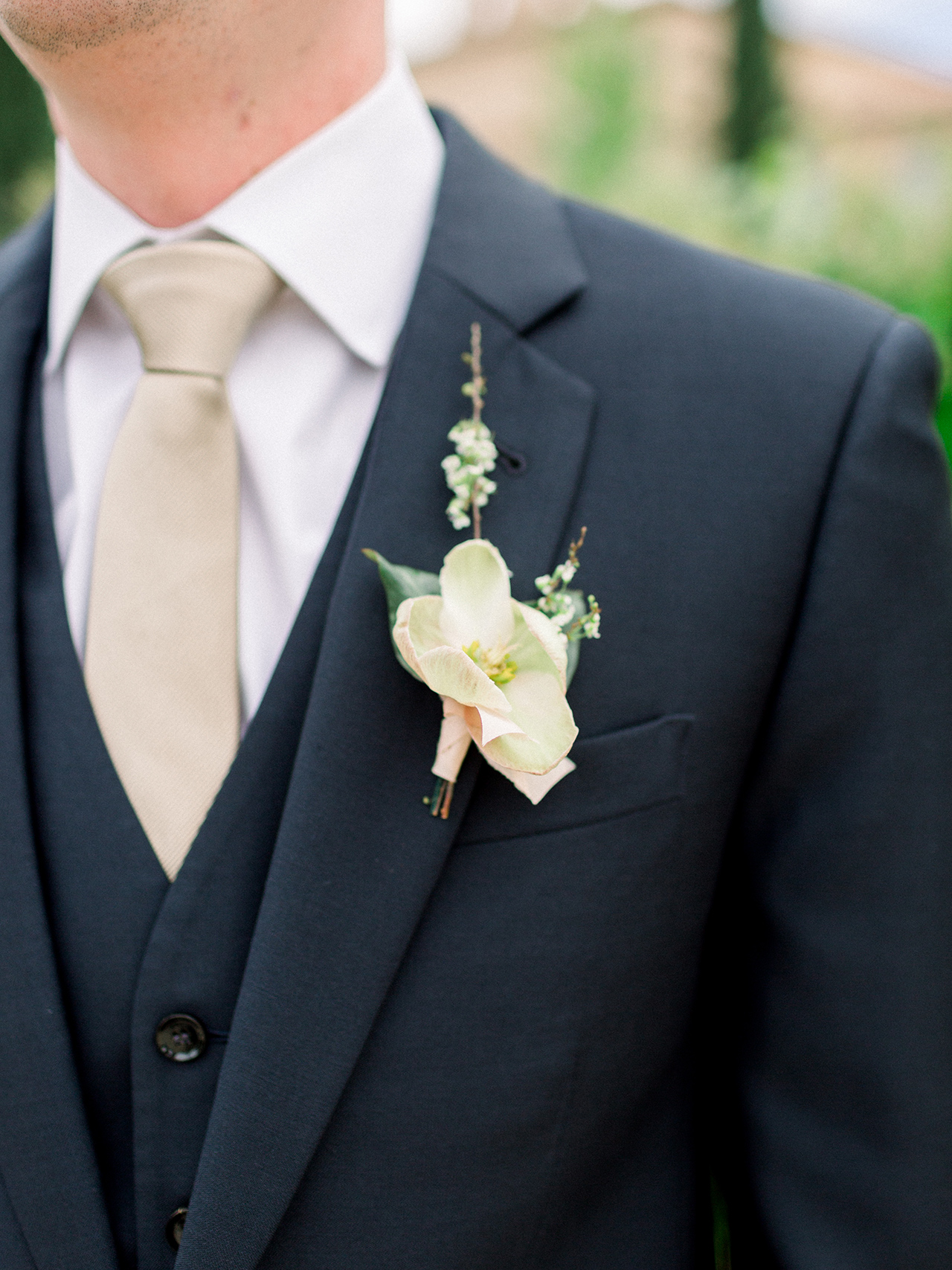 hellebore blossom grooms boutonniere