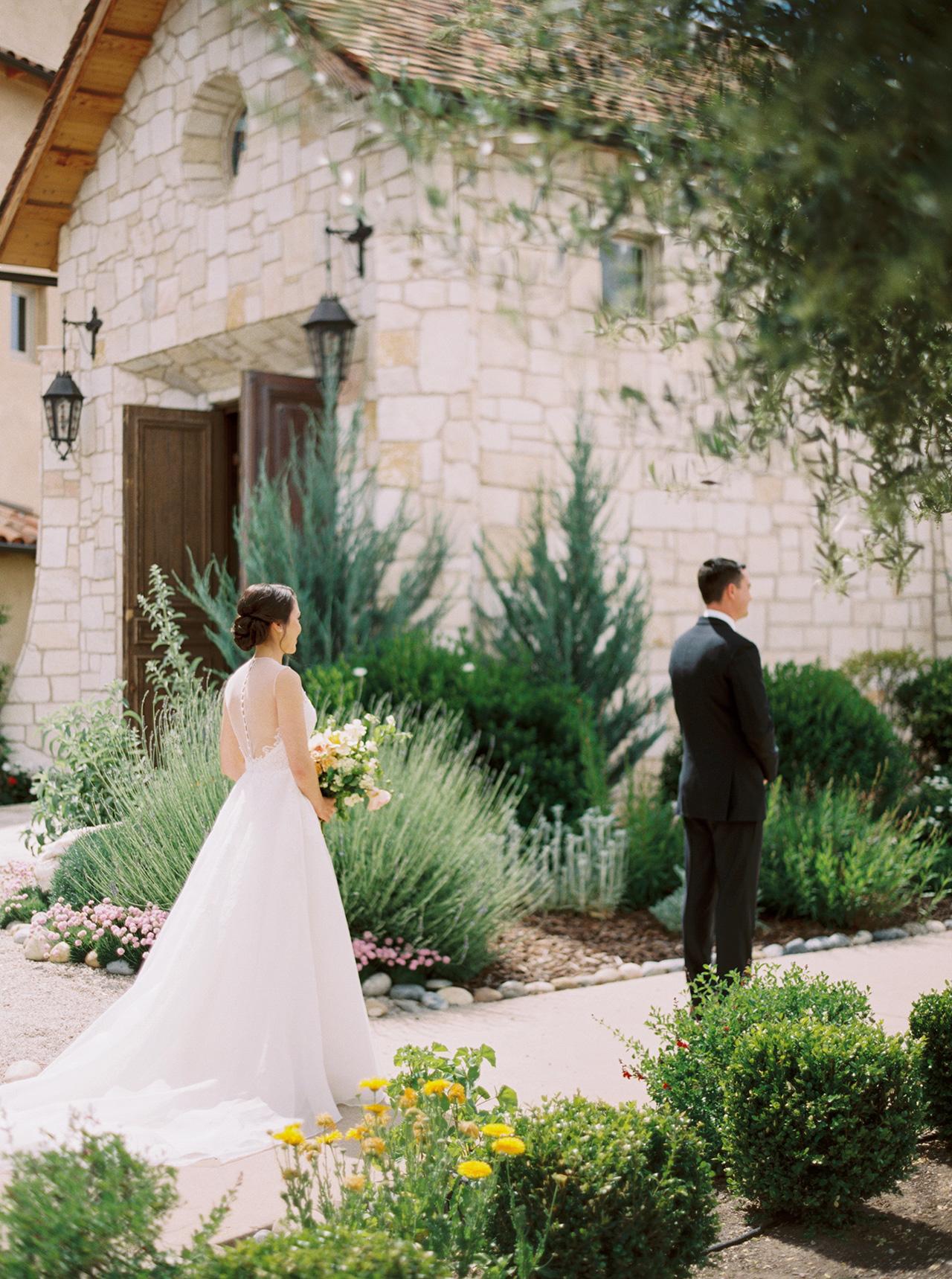 bride groom wedding first look outside tuscan building