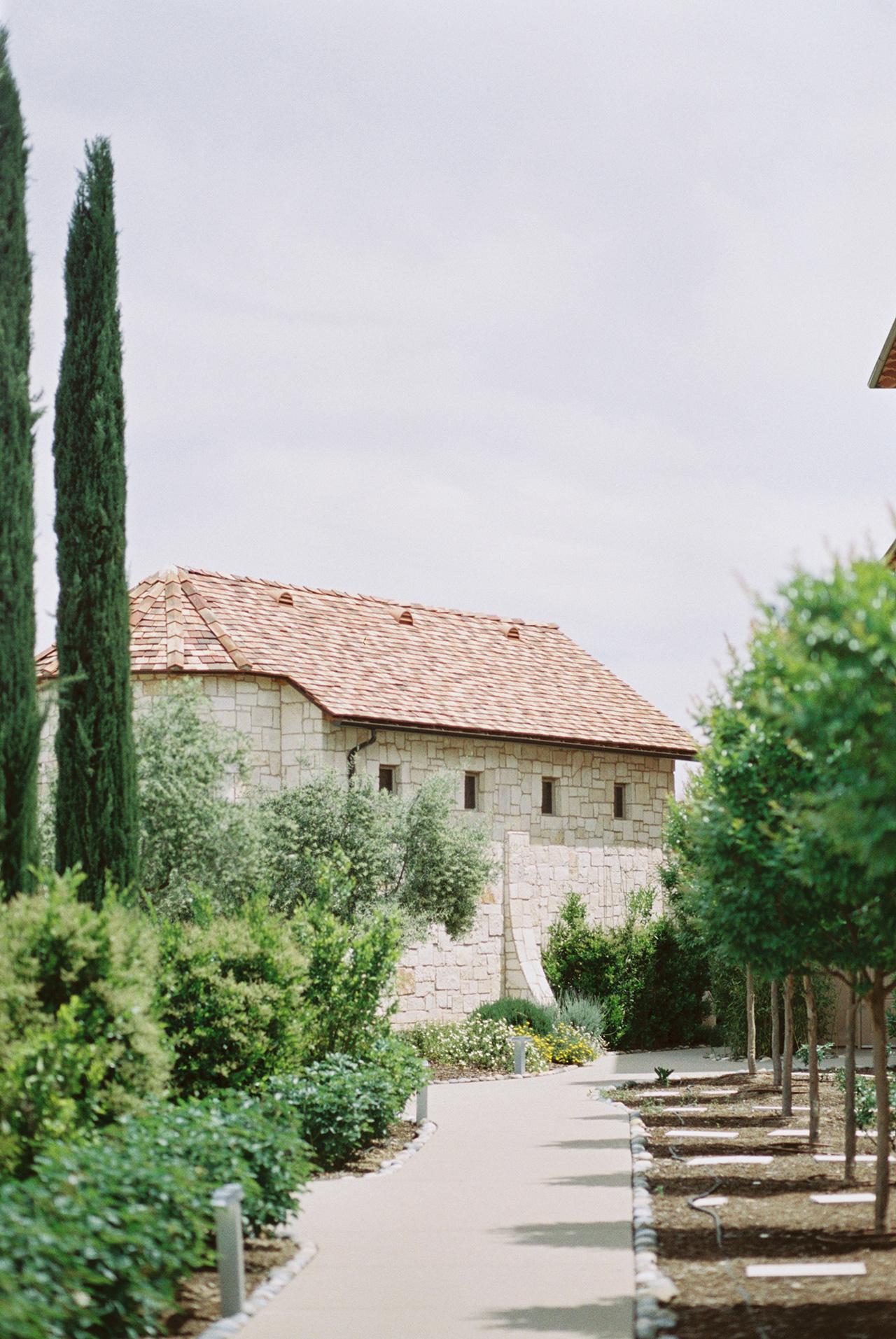 vineyard resort sidewalk and gardens to building