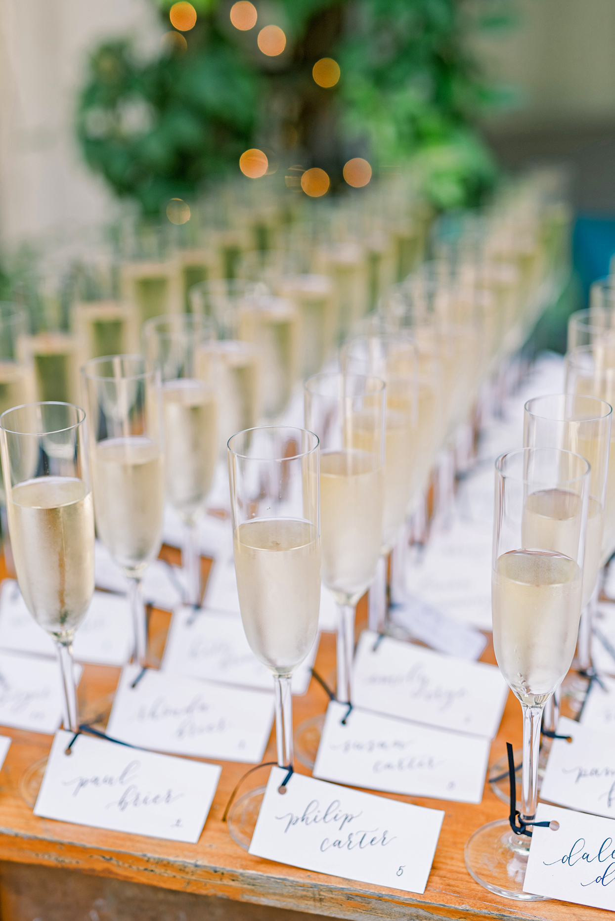 champagne wedding ideas glasses with nametags