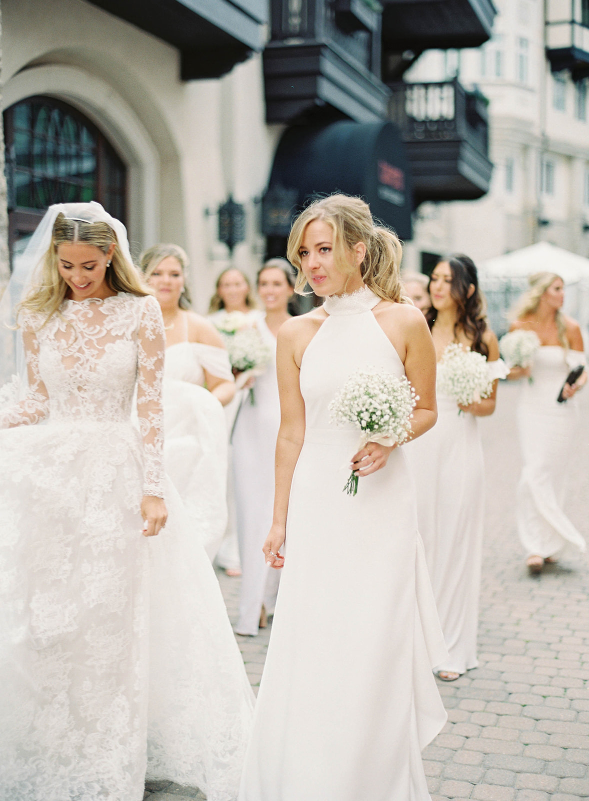 bride bridesmaids walking in white dresses