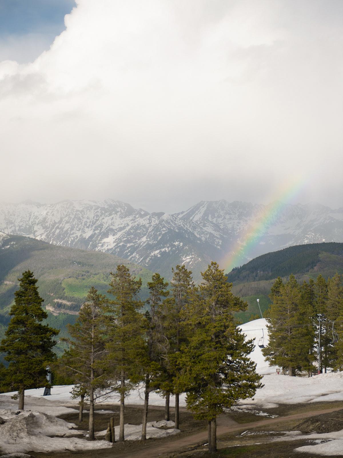 Colorado mountain view fog rainbow scene