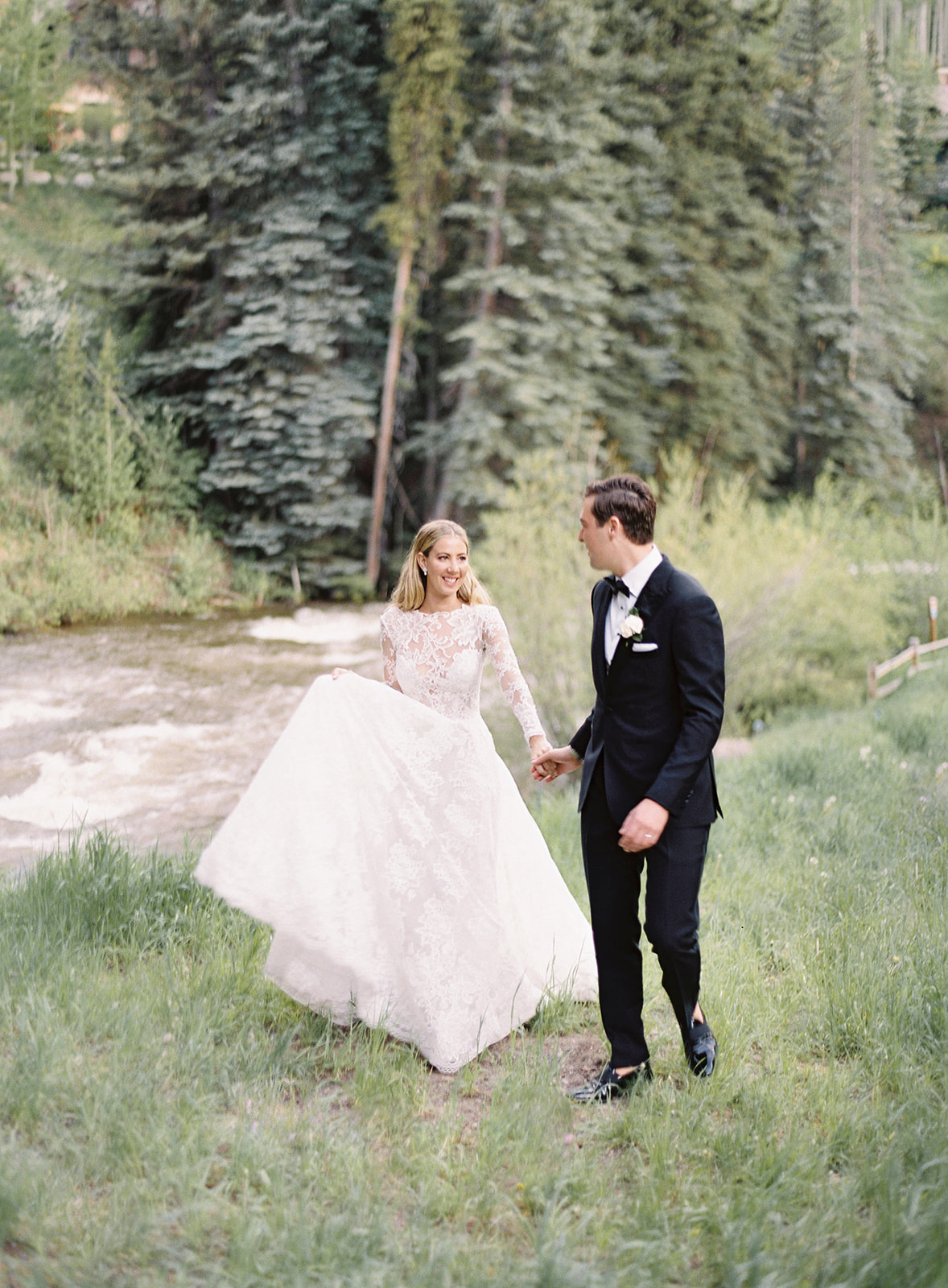 bride groom walk through woods wedding attire