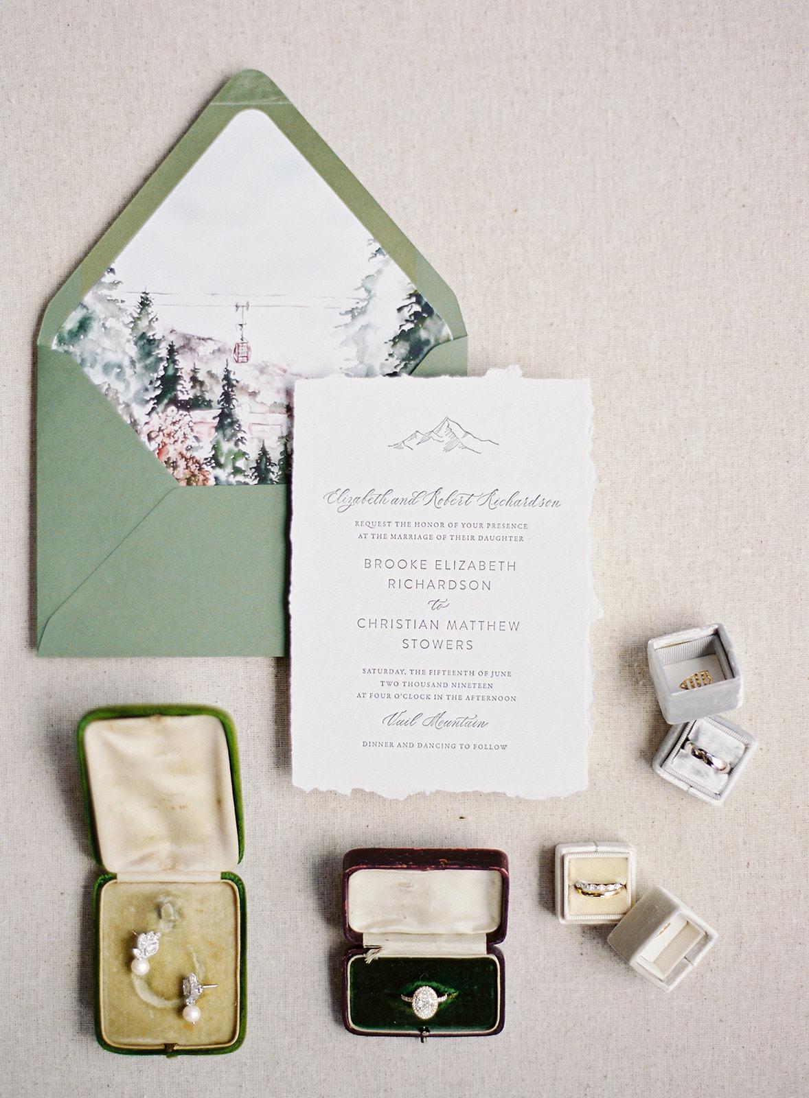 green envelope mountain theme invitations