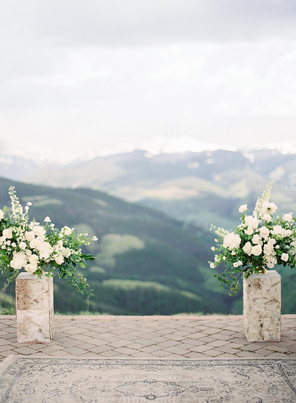white floral arrangements wedding ceremony mountain view