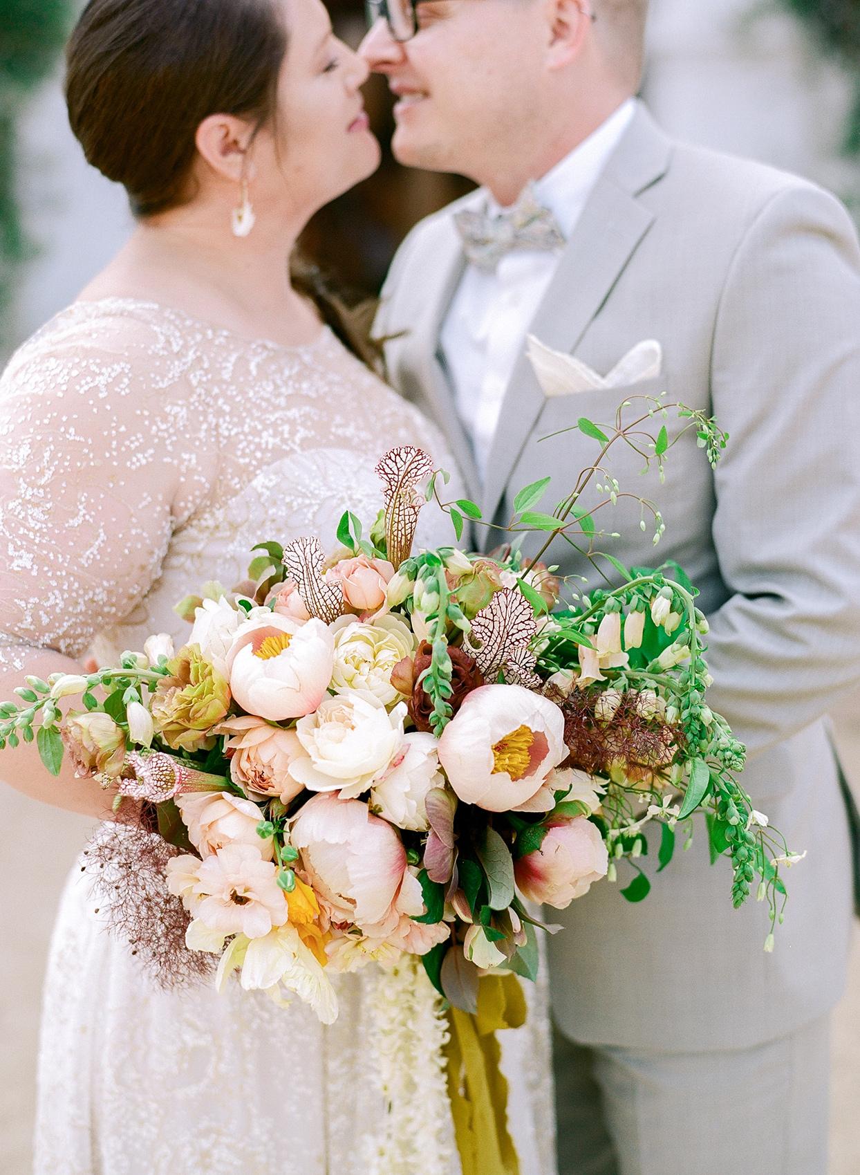 nina devon couple bride holding wedding bouquet