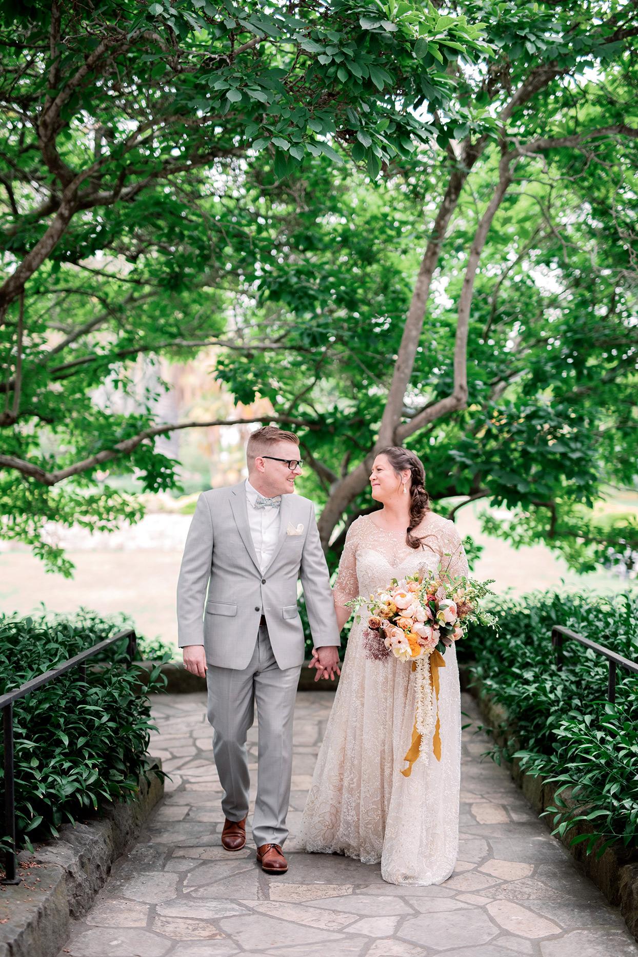 nina devon wedding couple walking on stone path