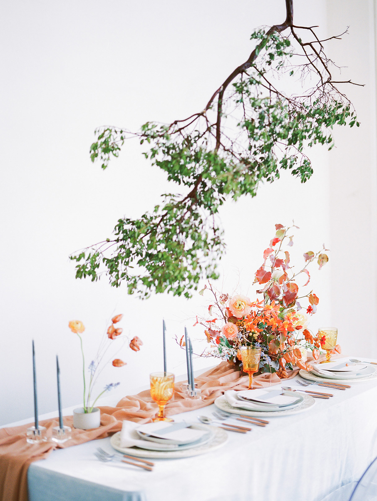 floating twig branch centerpiece over table
