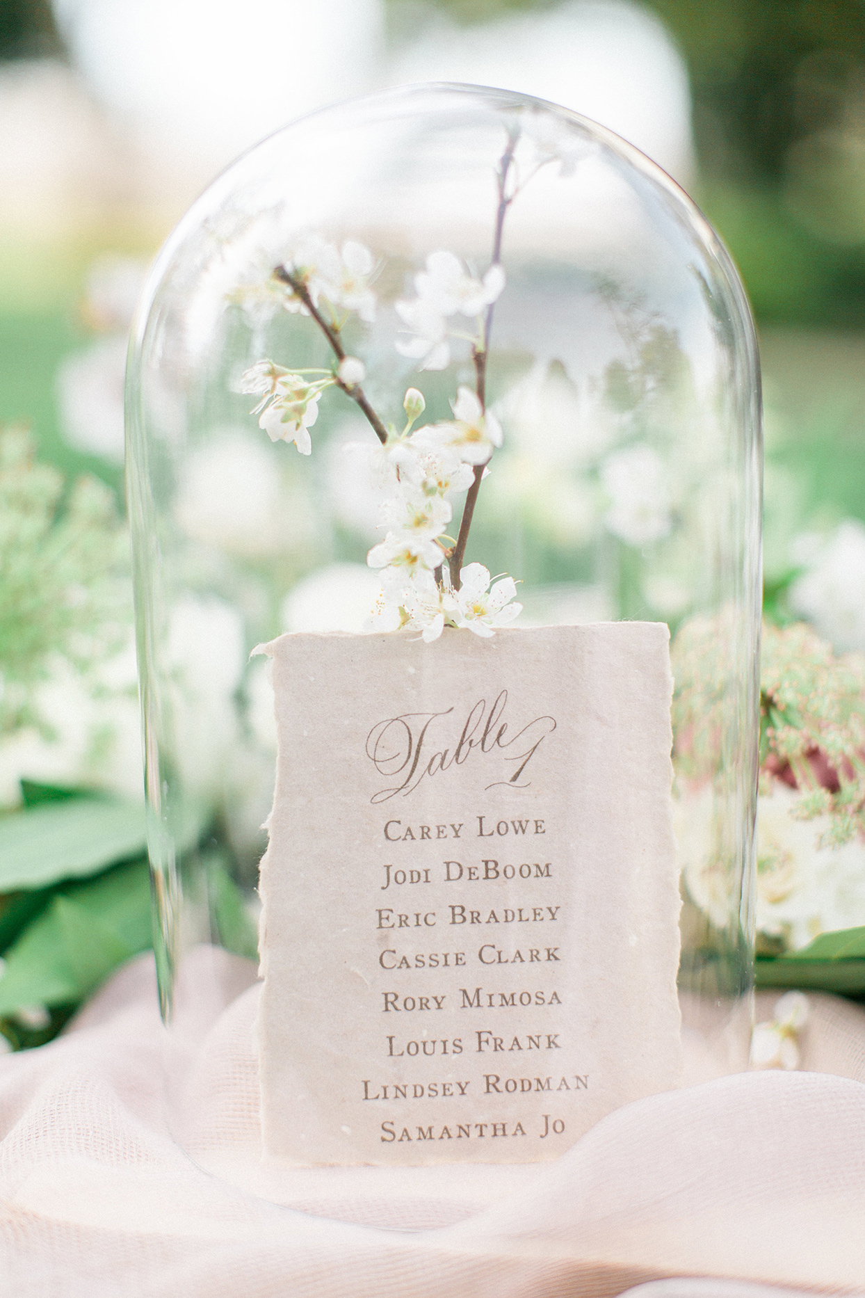 cloche table decoration with twig branches