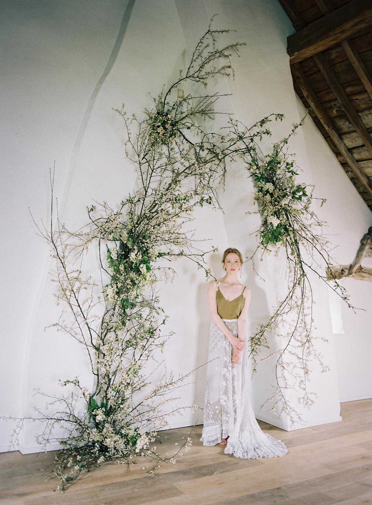 twig branch on wall altar area