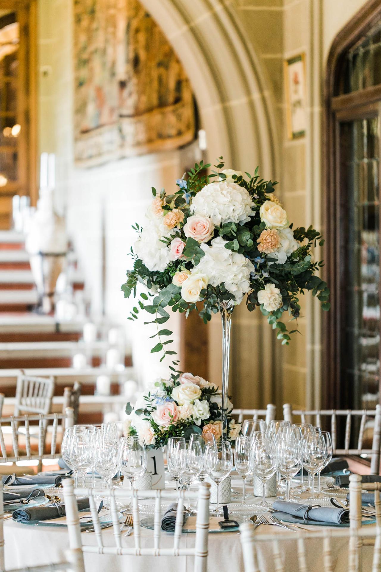 tall short floral arrangements reception tables