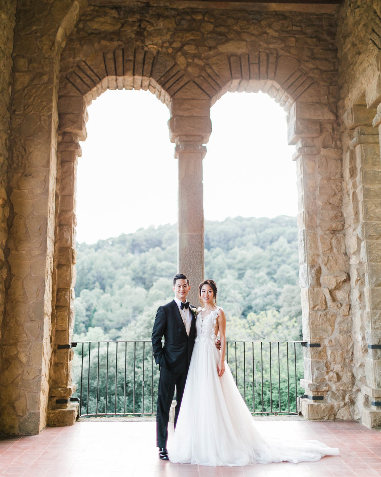 bride groom wedding day pose castle balcony view