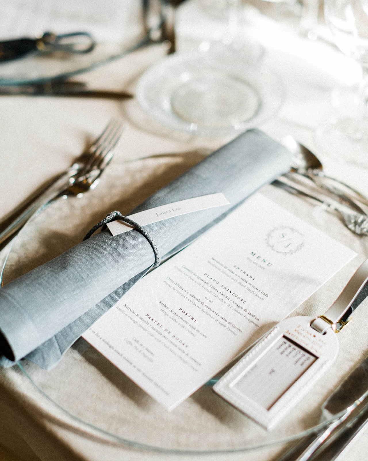 translucent plate with menu and luggage tag favor