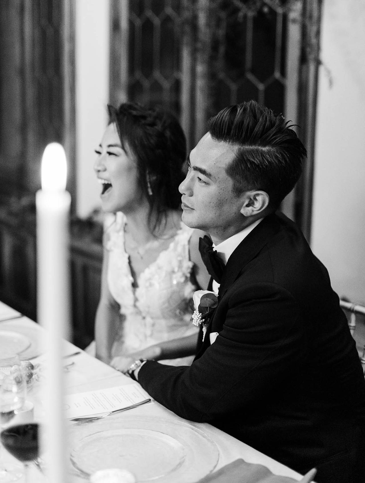 bride and groom enjoy speeches before dinner