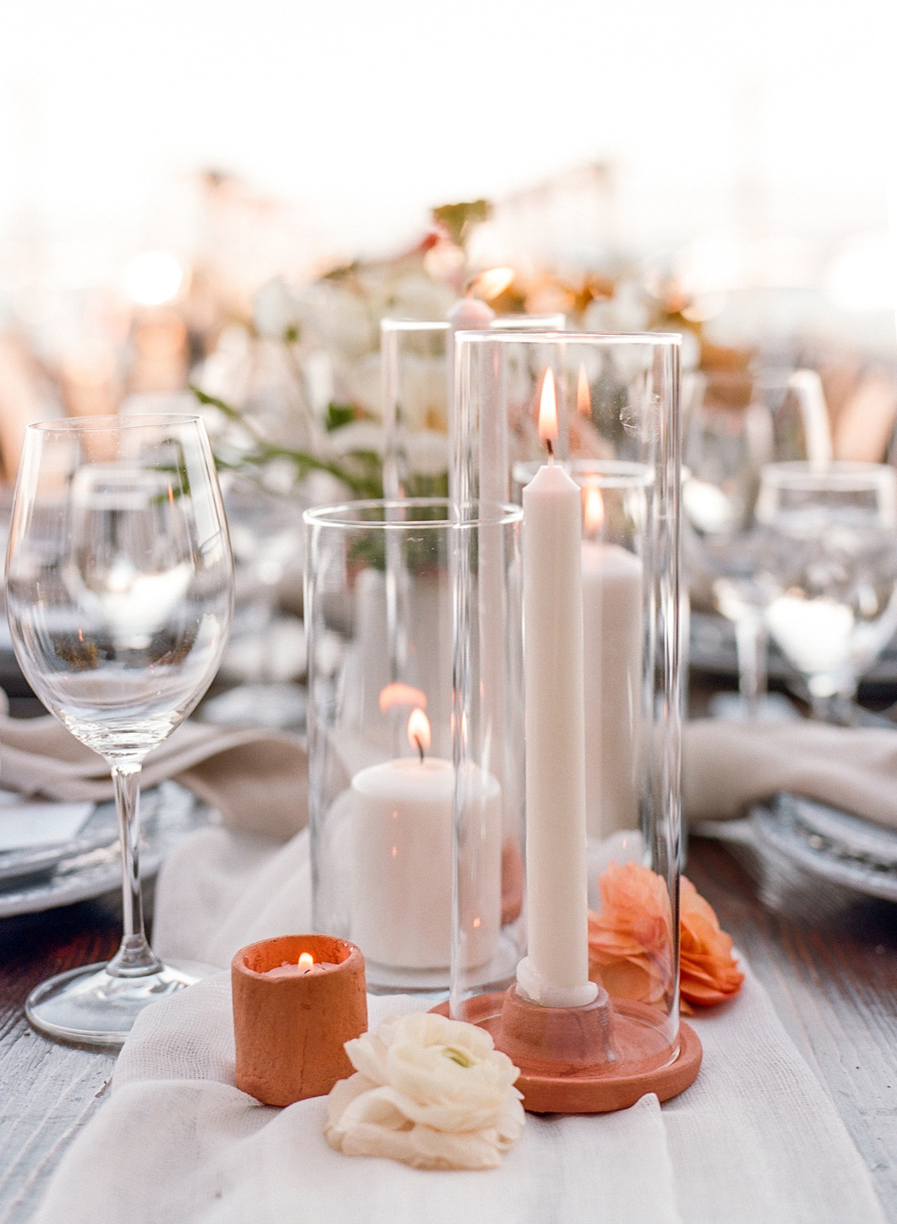 white candle terra cotta table centerpiece