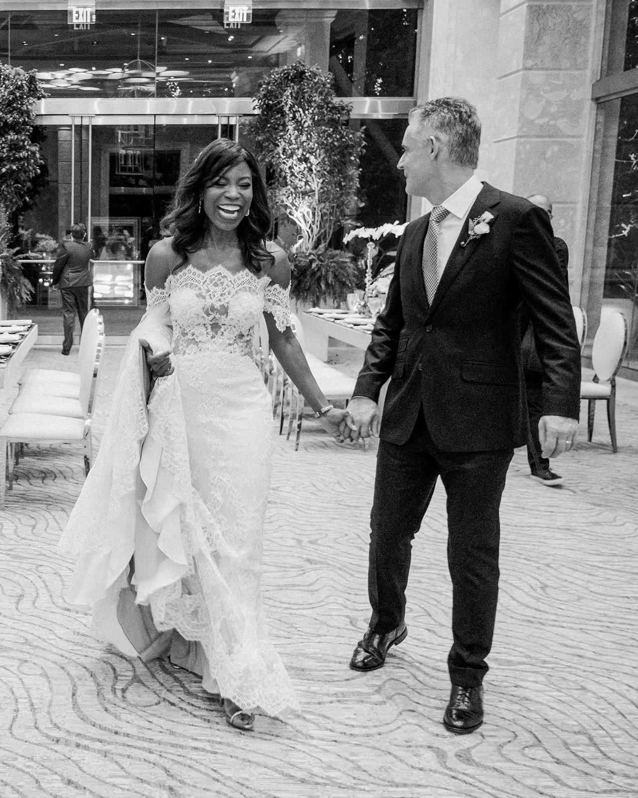 bride groom hold hands reception area