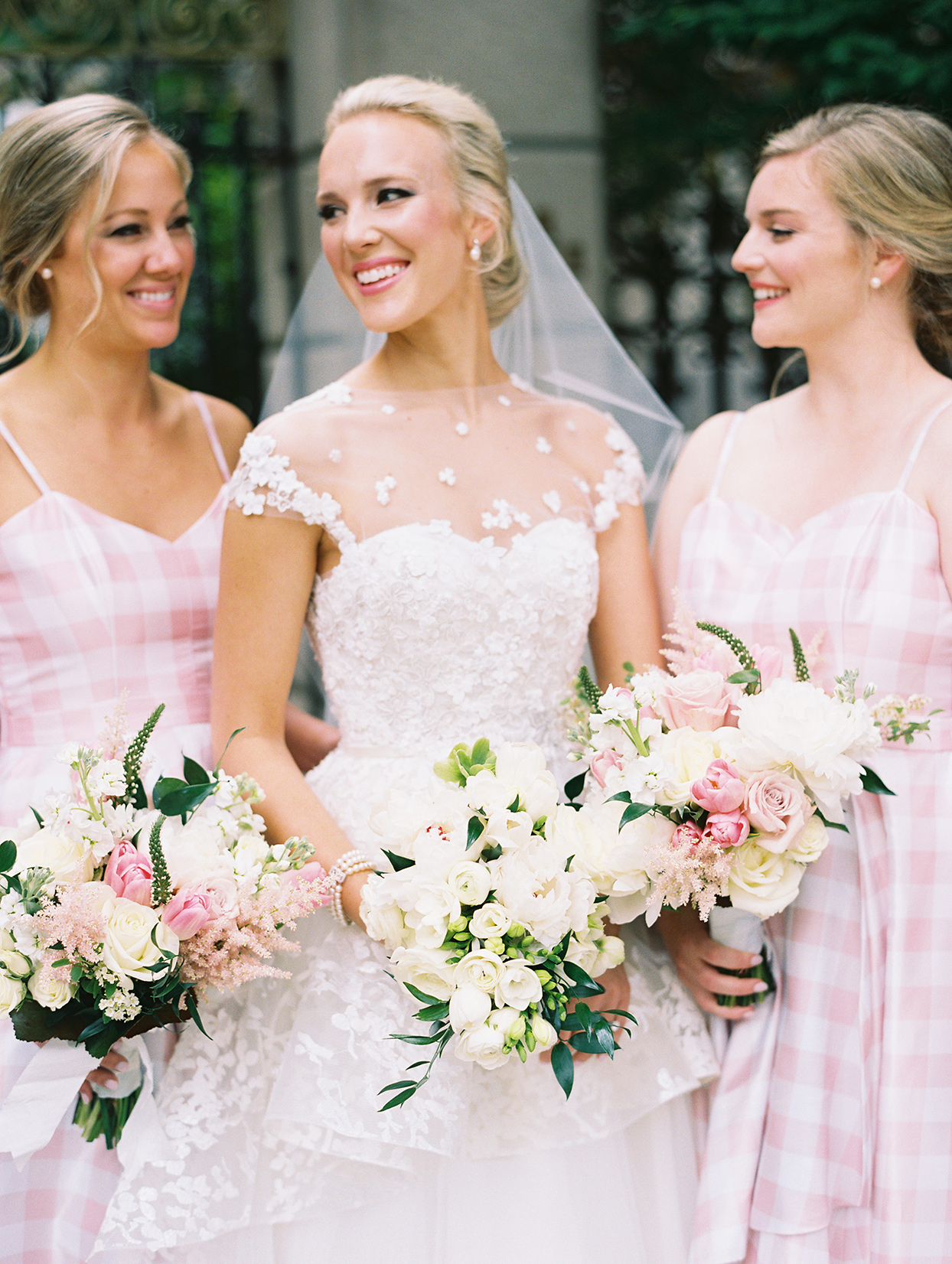 gigi kyle bride and maids holding wedding bouquets