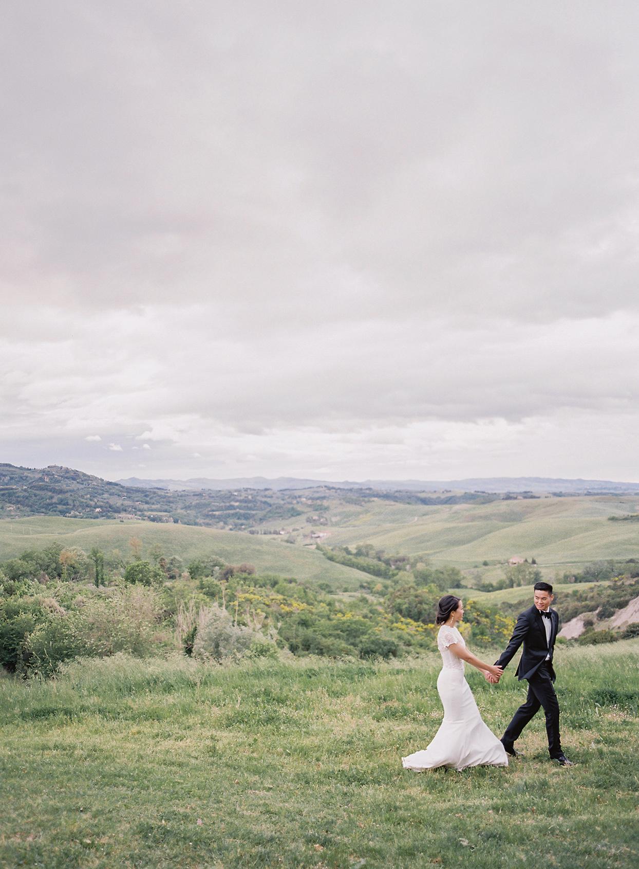 jen alan wedding couple walking through field