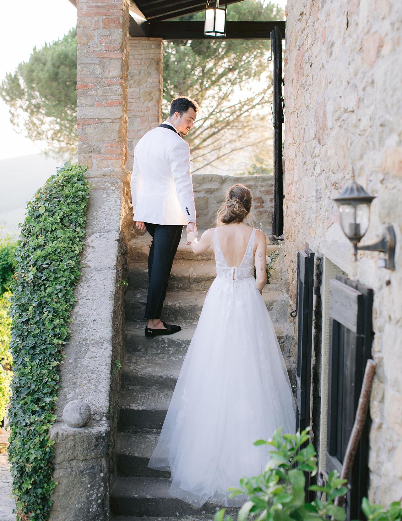 bride groom walk up building stairs