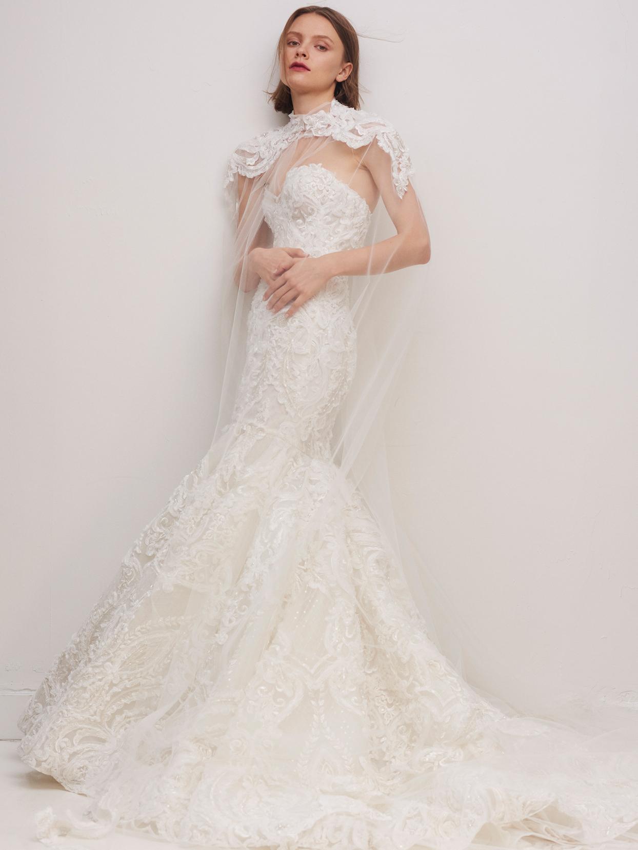 rivini by rita vinieris lace strapless mermaid wedding dress with sheer cape fall 2020