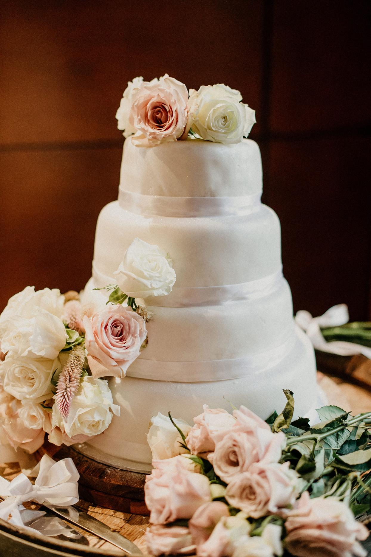 four tiered white wedding cake