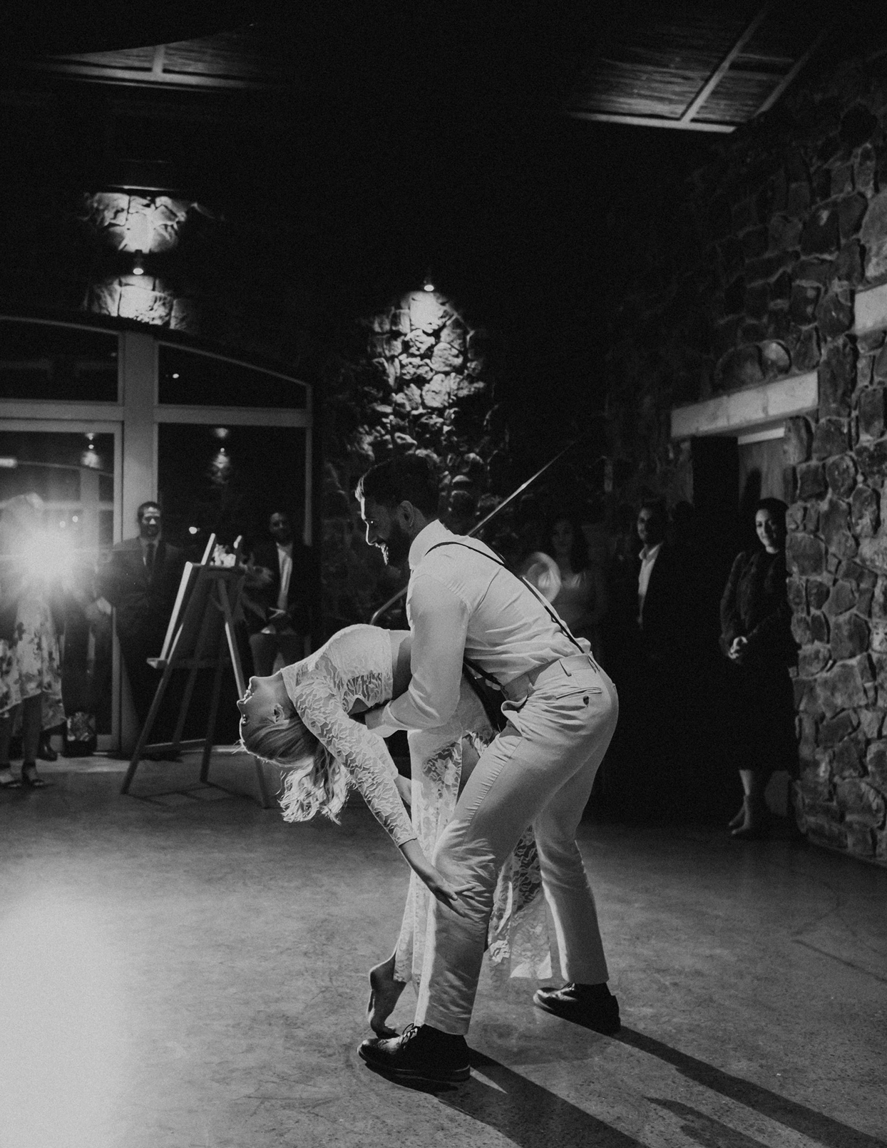 groom dips bride during first dance