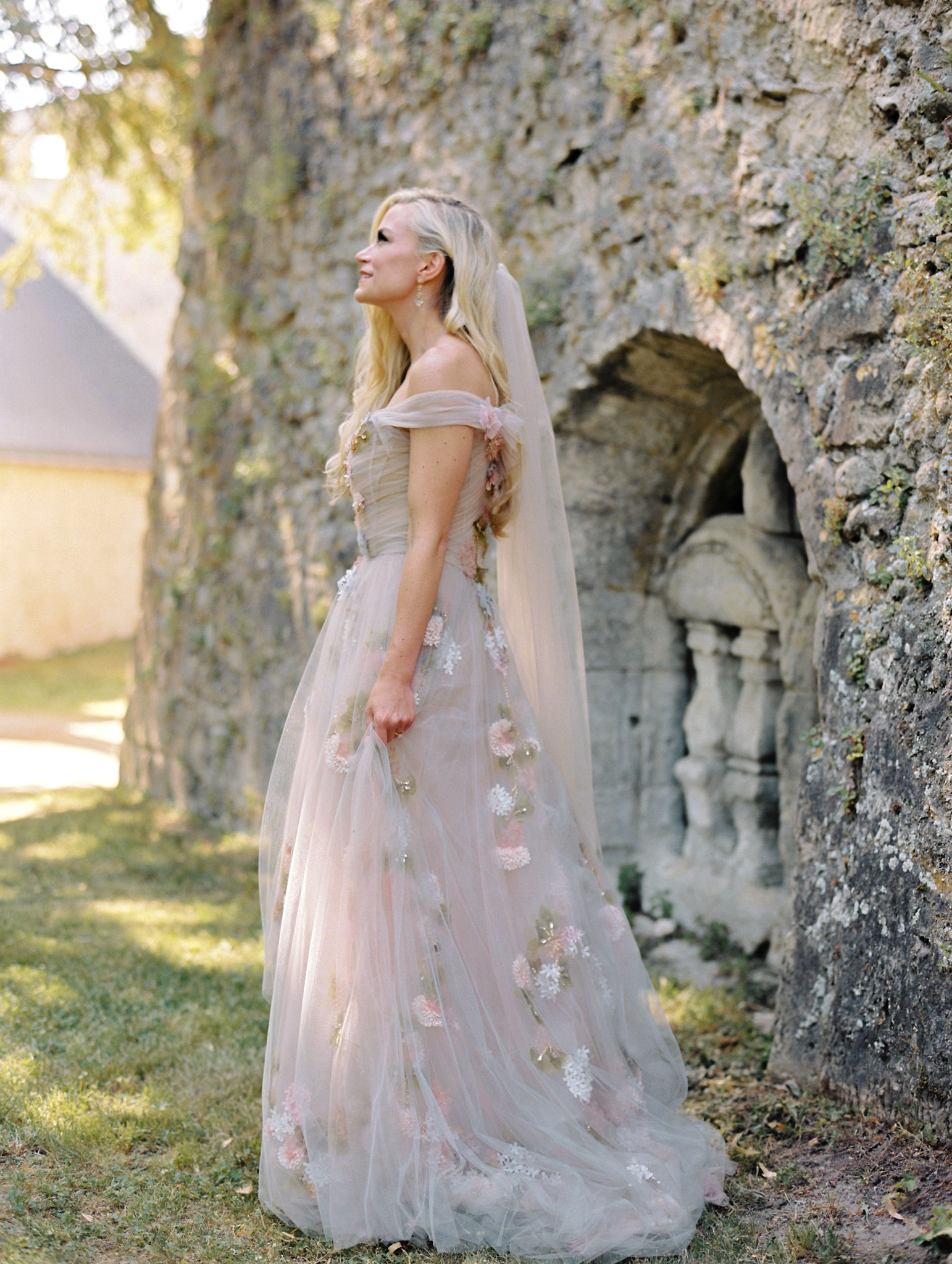 portrait bride profile in front of old stone building