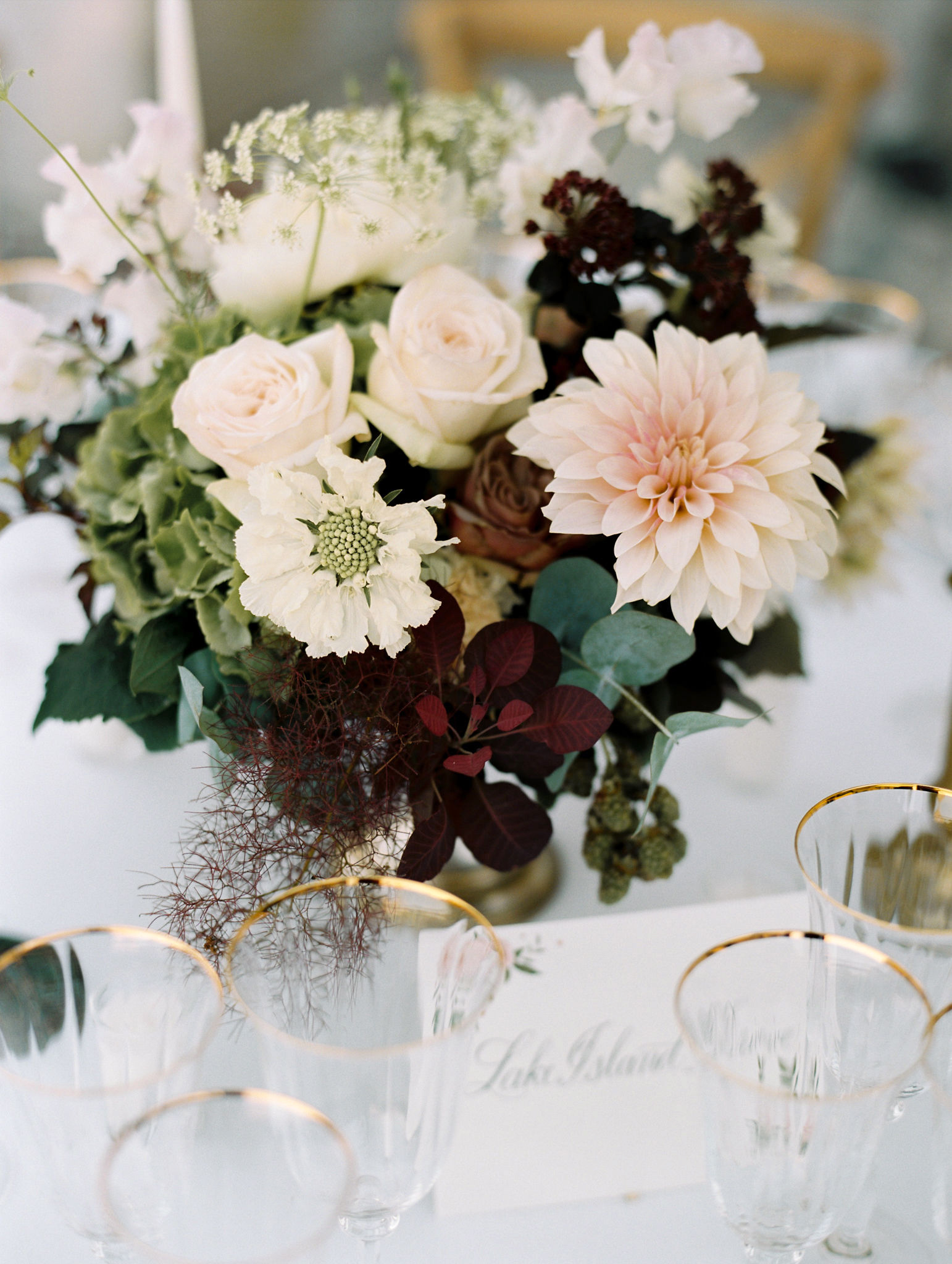 close-up floral centerpiece on reception table