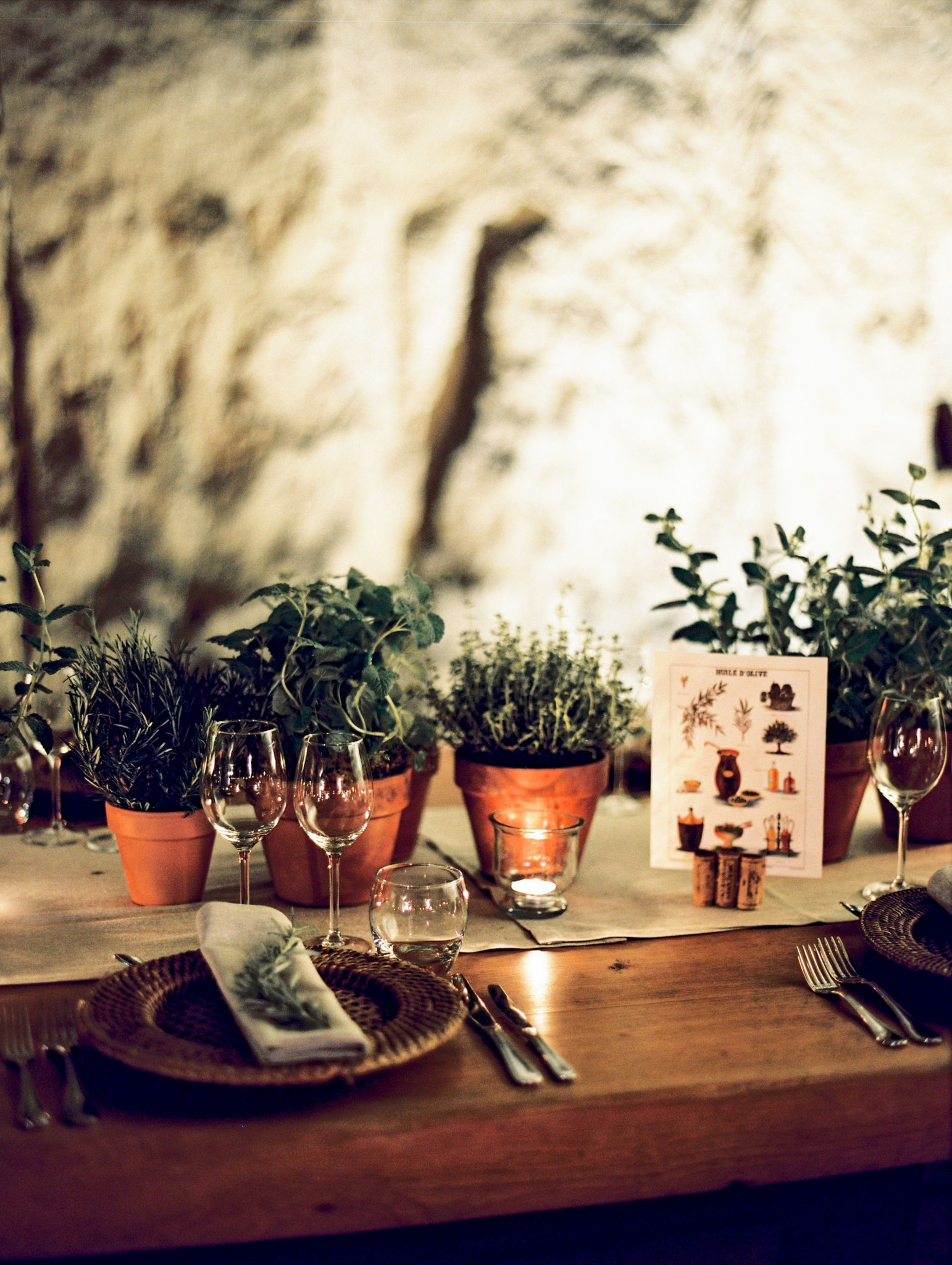 rehearsal dinner table settings with potted herb centerpieces