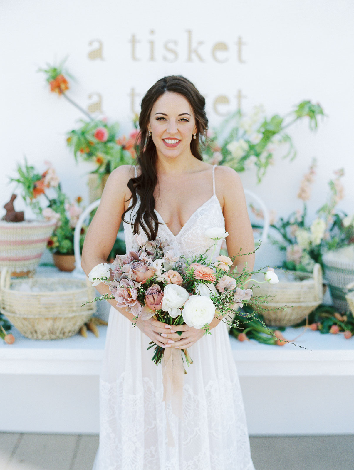 bride holding pastel colored flowers wedding bouquet